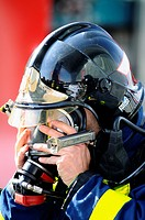 Fireman putting on oxygen mask