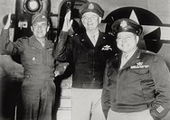 On their return from Europe, the U.S. General Anthony McAuliffe, Paul Williams and John Doyle greeting smiling. New York, July 1945