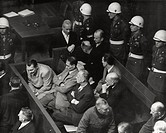 During a break of a hearing of the International War CrimesTribunal, Hermann Goering talks with the defending counsel. In thefirst row there are too: ...