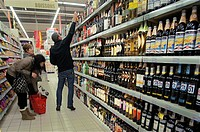 France, Aquitaine, Dordogne, buying alcohol in a Supermarket, at Mussidan.