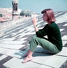 The French actress Anouk Aimee sitting on the Hotel Excelsiorroof. Venice, 1955