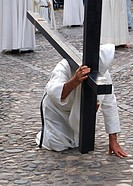 Nazarene kneeling on a street