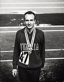 The race walker Abdon Pamich _ smiling with the Olympicgold medal _ on the highest step of the podium of the 50 km finalOlympic race. The Italian race...