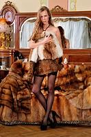 Beautiful woman in fur coat in a luxurious classical interior.