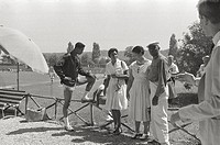 American athlete relaxing with his relatives at the Rome OlympicGames. Rome, 1960