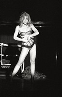 French stripteaser and actress Sidonie Paquin performing astriptease in a nightclub. Milan, 1960s