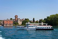 Passenger ferry in front of the Scaliger castle, 9th century, one of the best preserved fortifications on Lake Garda, Lazise, Verona province, Veneto,...