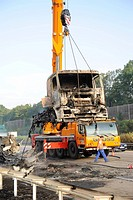A burned_out truck engine being salvaged by a crane on the A8 motorway, Stuttgart, Baden_Wuerttemberg, Germany, Europe