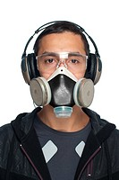 Young Man Wearing Goggles, Respirator and Hearing Protection