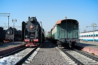 Russian steam locomotive and vintage car
