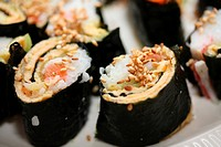Makisuski, rice, egg and salmon rolled in seaweed, traditional Japanese cuisine
