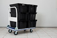 Industial warehouse cart with the stack of empty conainers