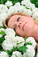 Young woman laying in flowers _ snowballs