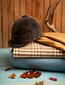 Still life of a horseback riding cap