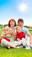 Happy family with two children outdoor