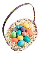 A shot of colorful easter eggs in a basket