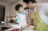 Dad and young son cooking in the kitchen