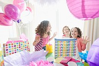 Girls opening gifts at birthday party