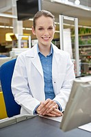 Portrait of female cashier in supermarket (thumbnail)