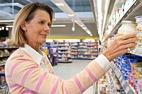 Woman doing shopping in supermarket