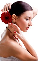 isolated portrait of beautiful brunette girl with red gerbera flower in her hair