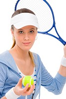 Tennis player _ young woman holding racket in fitness outfit