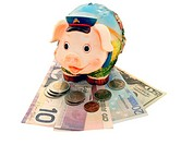 Funny piggy bank with banknotes on the white background