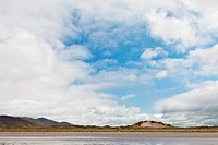 Dunes blue sky with white clouds and sandy beach at Dingle Peninsula Ireland nice background with copy space