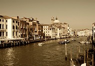 Venice, canals and historic buildings with speedboats
