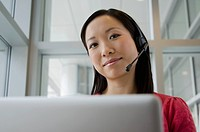 Business woman with headset (thumbnail)