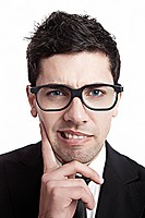 Funny portrait of a young businessman with a nerd glasses