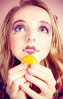 A young woman loves her sweet macaron.