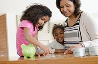 Mom teaching daughters about money.