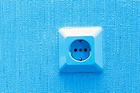 electric socket on wall, blue abstract background