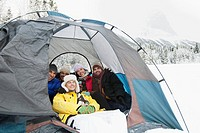 Young adults enjoying winter camping