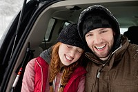 Couple sitting in hatchback