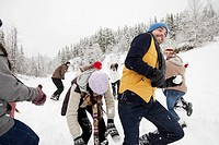 Adults having a snowball fight in the countryside (thumbnail)