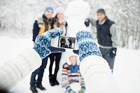 Picture taking with snowman (thumbnail)