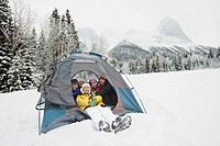 Young adults enjoying winter camping (thumbnail)