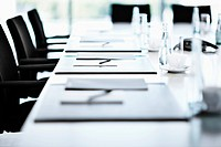 Close up of table in board room prepared for conference