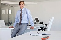 Young smiling businessman in office