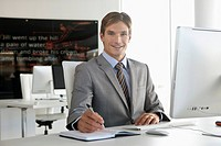 Portrait of smiling businessman in office (thumbnail)