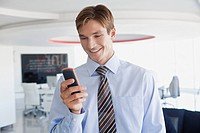 Smiling businessman using cell phone
