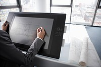 Architect using digitized pen on tablet
