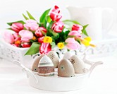 Easter eggs with tulips as table decoration