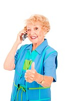 Senior woman on her cellphone gives a wink and a thumbs up sign for good reception.