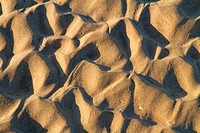 Complex beach sand ripple pattern close up at sunset
