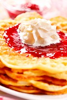 Waffles with fresh strawberry jam and whipped cream
