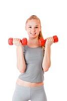 Young blond woman training with dumbbells isolated over white background