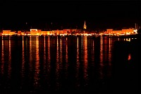 View of the sea and the city at night, Croatia, Porec